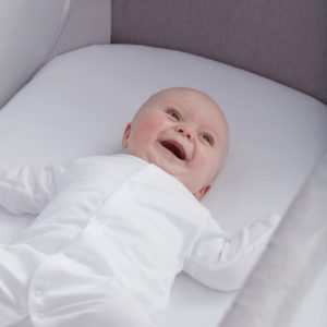 Baby-Laughing-in-Cot-min